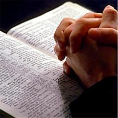 bible_&_praying_hands